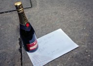 "A bottle of champagne and a note reading, ""Thank you for everything Sire, good retirement"" signed by the youngsters of cdH stands in front of the royal palace at the Paleizenplein - Place des Palais in Brussels, on July 3 2013"
