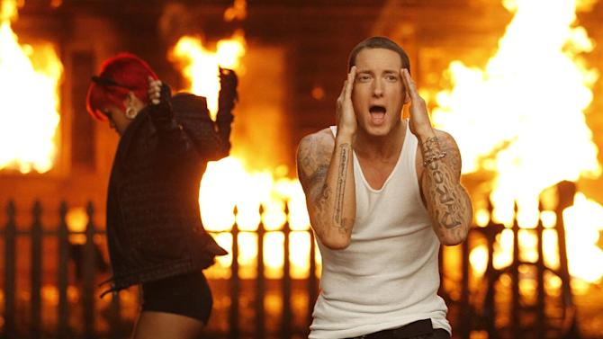 "In this image released by Interscope Records, Eminem, right and Rihanna are shown during the filming of their music video, ""Love the Way You Lie"" which is nominated in the new category Best Video with a Message at the 2011 MTV Video Music Awards on Sunday, Aug. 28, 2011. (AP Photo/Interscope Records)"