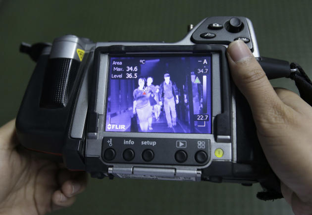 Passengers are seen on a thermal scanner as they arrive at Manila's International Airport in Paranaque, south of Manila, Philippines on Wednesday, April 16, 2014. Philippine officials said a Filip