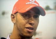 British driver Lewis Hamilton, pictured here on September 20, is to replace Michael Schumacher at Mercedes next season, the Formula One firm has announced, bringing to an end months of speculation about his future at McLaren