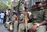 Armed Indian policemen on guard at the main gate of the M. Chinnaswamy Stadium in Bangalore on December 25, 2012. Police were out in full force in Bangalore on Tuesday as part of a massive security operation ahead of Pakistan's first cricket tour of India for five years