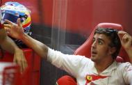 Ferrari Formula One driver Fernando Alonso of Spain attends the first practice session of the Singapore F1 Grand Prix at the Marina Bay street circuit in Singapore September 20, 2013. REUTERS/Pablo Sanchez