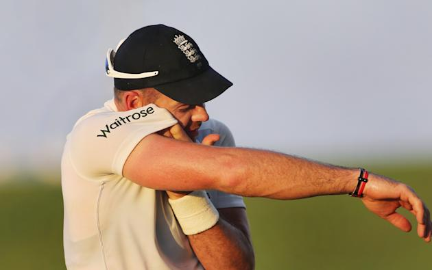 England's James Anderson walks off at the end of the days play