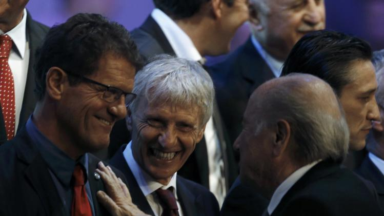 Capello chats with Blatter during the draw for the 2014 World Cup in Sao Joao da Mata