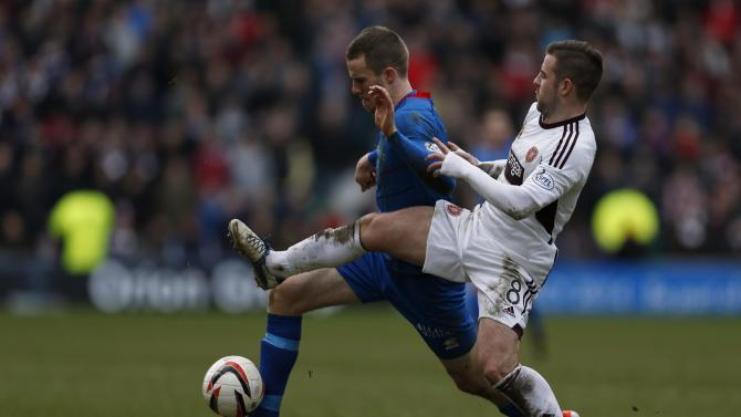 Inverness Caledonian Thistle's Watkins is challenged by Hearts' Robinson during their Scottish League Cup semi final soccer match at Easter Rd Stadium in Edinburgh