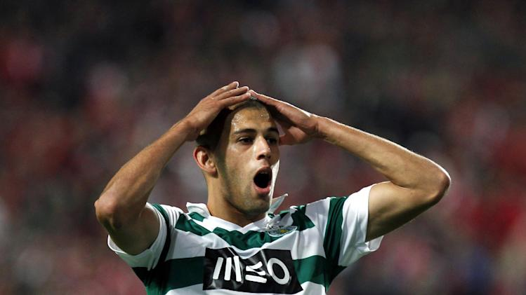 Sporting's Islam Slimani, from Algeria, reacts after missing a chance to score during a Portugal Cup soccer match between Benfica and Sporting at Benfica's Luz stadium in Lisbon, Saturday, Nov. 9, 2013. Benfica won 4-3 in extra time
