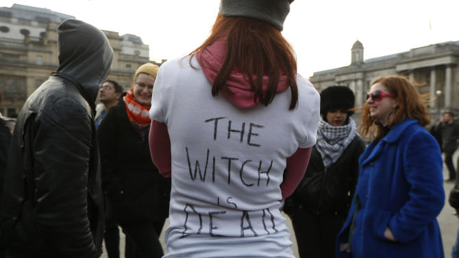 "Anti-Thatcher protesters react to the death of  former British Prime Minister as they gather at Trafalgar Square in London, Monday, April 8, 2013.  Opponents of the late Margaret Thatcher are taking a kind of musical revenge on the former prime minister, pushing the song ""Ding Dong! The Witch is Dead"" up the British charts in a posthumous protest over her polarizing policies. By Friday, April 12, 2013,  the online campaign had propelled the ""Wizard of Oz"" song to No. 1 on British iTunes and into the top five of the music chart used by the BBC to compile its weekly radio countdown. The unusual campaign has caused a headache for the BBC. With the ditty near the top of the charts, the broadcaster faced the prospect of airing the words ""The Wicked Witch is Dead!"" on its Sunday countdown show, just days before Thatcher's funeral, scheduled for Wednesday.  (AP Photo/Sang Tan)"