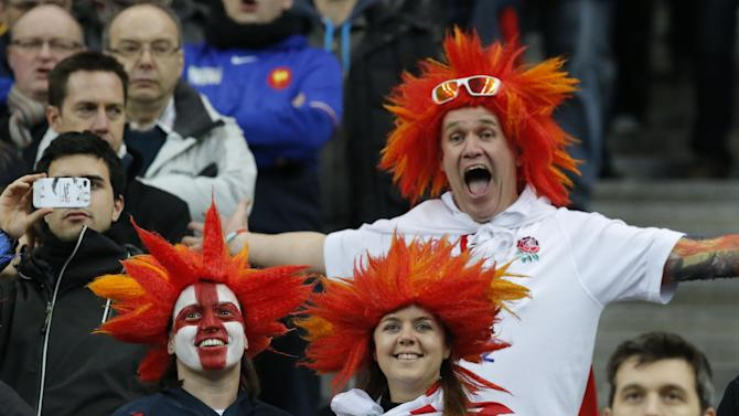 England's supporters cheer during the the British National anthem prior to a Six Nations international rugby union match between France and England at Stade de France stadium in Saint Denis, near Paris, Saturday, Feb. 1, 2014. France won against England 26-24