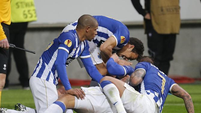 Porto's players celebrate their side's third goal during a Europa League round of 32 second leg soccer match between Eintracht Frankfurt and FC Porto in Frankfurt, Germany, Thursday, Feb. 27, 2014