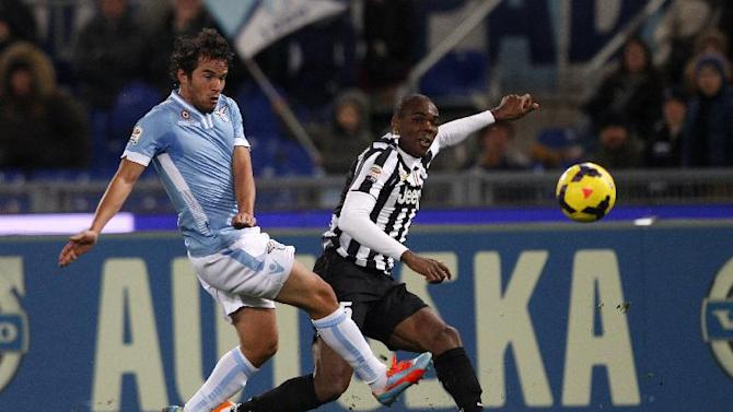 Juventus defender Angelo Ogbonna is challenged by Lazio midfielder Alvaro Gonzalez, of Uruguay, left, during a Serie A soccer match between Lazio and Juventus, at Rome's Olympic stadium, Saturday, Jan. 25, 2014