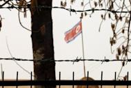 A North Korean flag flutters behind a barbed wire fence at the embassy in Beijing. North Korea's recent rocket launch -- which failed when it disintegrated shortly after blastoff -- was carried out despite international pressure including from China