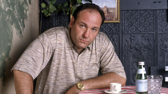 """FILE - This 1999 file photo provided by HBO, shows James Gandolfini as mob boss Tony Soprano, in an episode from the first season of the HBO cable television mob series, """"The Sopranos."""" HBO and the managers for Gandolfini say the actor died Wednesday, June 19, 2013, in Italy. He was 51. (AP Photo/HBO, Anthony Neste, File)"""