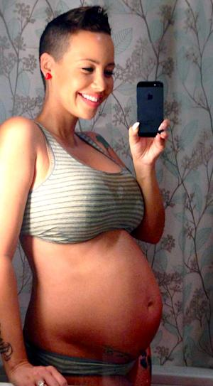 PICTURES: Pregnant Amber Rose Flaunts Bare Baby Bump at 28 Weeks