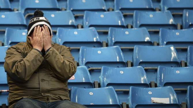 A Tottenham Hotspur fan reacts after his team lost 6-0 against Manchester City in their English Premier League soccer match at the Etihad Stadium in Manchester