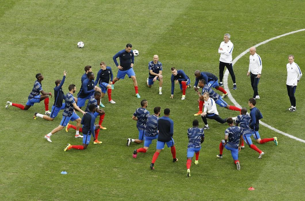 France players warm up before the match