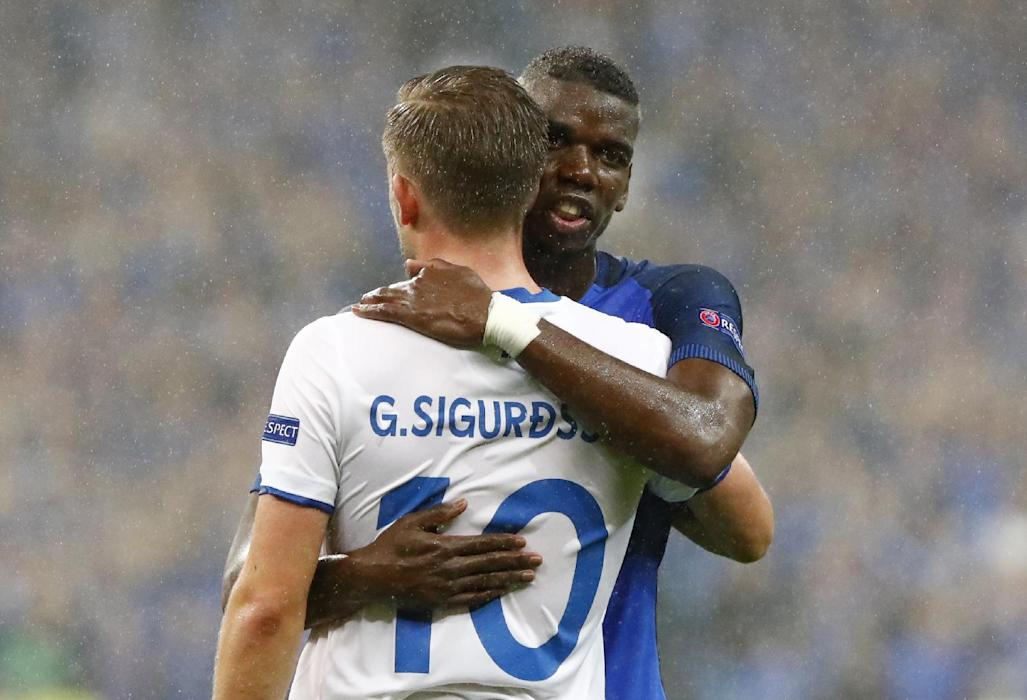 Iceland's Gylfi Sigurdsson and France's Paul Pogba at the end of the game