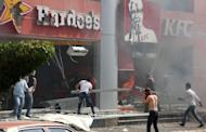 """Lebanese men ransack US fast food chains Hardee's and KFC as they protest against the controversial film """"Innocence of Muslims"""" in the northern Lebanese city of Tripoli"""