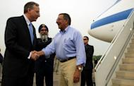 US Ambassador to Singapore David Adelman (L) greets Secretary of Defense Leon Panetta upon Panetta's arrival at Paya Lebar Airfield in Paya Lebar, Singapore, on June 1. Panetta was in Singapore to attend the 11th Aisia Security Summit