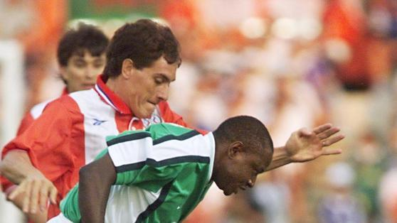 Nigerian Forward Rasheed Yekini (foreground) Fighting For The Ball With An Unidentified Paraguyan Player In Toulouse AFP/Getty Images