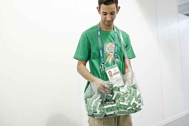 A staff member carries condoms to refill vending machines at the Olympic Village in Rio de Janeiro, Brazil. (Yasuyoshi Chiba/Getty Images)
