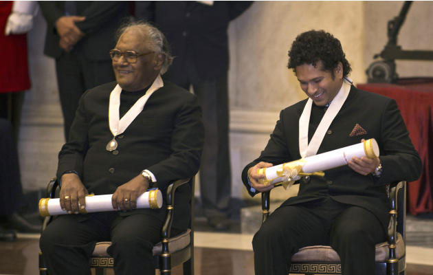 "India's cricket icon Sachin Tendulkar, right, and eminent scientist C.N.R. Rao smile after receiving the ""Bharat Ratna"" award at an awards ceremony at the Presidential Palace in New Delh"