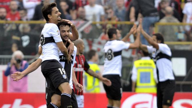 Parma's Parolo celebrates with his team mate Da Silva after scoring a goal against AC Milan during their Italian Serie A soccer match at the Tardini stadium in Parma
