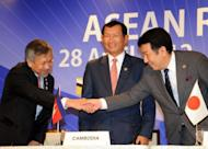 "Philippines' trade and Industry Secretary Gregory Domingo (L), Japan's Economic, Trade and Industry Minister Yukio Edano (R) and Cambodia's Commerce Minister Cham Prasidh, seen here prior to their joint press conference following the ""ASEAN Road Show"" informal AEM-METI consultations in Tokyo, on April 28"