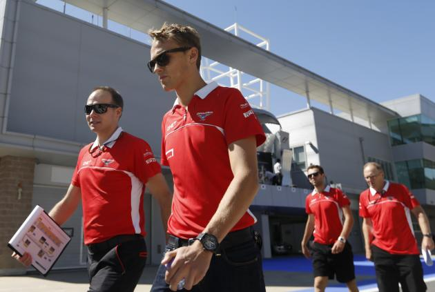 Marussia Formula One driver Chilton of Britain walks on the circuit before the Korean F1 Grand Prix in Yeongam