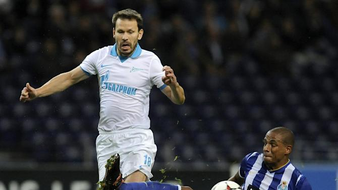 Porto's Fernando Reges, from Brazil, clears the ball from Zenit's Konstantin Zyryanov during the Champions League group G soccer match between FC Porto and Zenit Tuesday, Oct. 22, 2013, at the Dragao stadium in Porto, northern Portugal. Zenit won 1-0