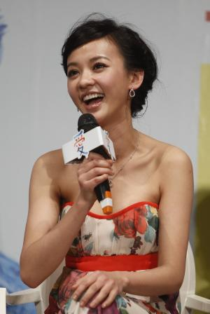 """FILE - In this Feb. 7, 2012 file photo, Taiwanese actress Ivy Chen reacts to questions during a media event in the lead up to the premiere of her new film entitled """"Love"""" in Taipei, Taiwan. Chen said she was hardly able to contain her excitement when she found out she had received her first Golden Horse nomination. """"When I heard the news, I wanted to scream,"""" the 30-year-old star said. """"However, I was filming at the time. The camera was still rolling outside, so I held it inside for two minutes."""" (AP Photo/Wally Santana, File)"""