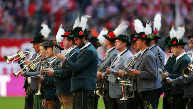 Bavarian musicians perform before the German first division Bundesliga soccer match between Bayern Munich and Borussia Dortmund in Munich