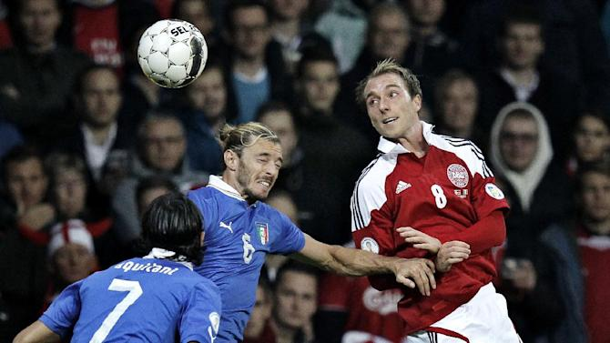 Italy's Alberto Aquilani, left, and Federico Balzaretti, center, and Denmark's Christian Eriksen during the 2014 World Cup Group B qualifying soccer match between Denmark and Italy at Parken Stadium in Copenhagen, Denmark, Friday Oct. 11, 2013