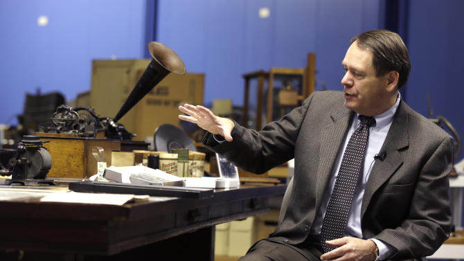 John Schneiter, a trustee at the Museum of Innovation and Science, talks about tinfoil phonographs on Wednesday, Oct. 24, 2012, in Schenectady, N.Y. Researchers have digitized what experts say is the oldest recording of a playable American voice and history's first-ever recorded musical performance, along with the first recorded blooper. Recorded on a sheet of tinfoil on a phonograph invented by Thomas Edison, the recording was made in St. Louis in 1878. It contains a short coronet solo of an unidentified song, followed by the voices of a man reciting popular nursery rhymes. (AP Photo/Mike Groll)