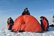 The boys of the Test Your Limits team set up the tent on Day 13 of the journey to the South Pole.