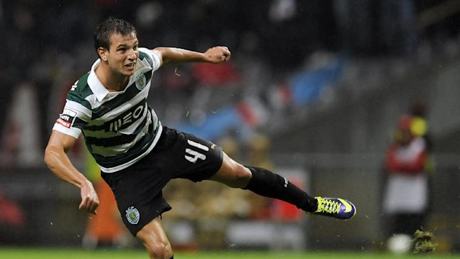 Sporting's Cedric Soares reacts after scoring his team second goal against Sporting Braga during their Portuguese League soccer match at the Municipal Stadium, in Braga, Portugal, Saturday Sept. 26, 2013. Cedric Soares scored once in Sporting's 2-1 victory