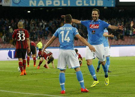 Napoli's Higuain celebrates with his teammate Mertens after scoring against AC Milan during their Italian Serie A soccer match at the San Paolo stadium in Naples