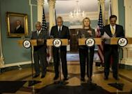 From left: Philippine's Secretary of National Defense Voltaire Gazmin, Philippine's Foreign Affairs Secretary Albert Del Rosario, US Secretary of State Hillary Clinton and US Secretary of Defense Leon Panetta arrive for a press conference at the US State Department in Washington, DC