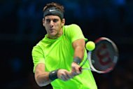 Argentina's Juan Martin Del Potro returns against Serbia's Janko Tipsarevic during their group B singles match in the round robin stage on the fourth day of the ATP World Tour Finals tennis tournament in London. Del Potro crushed Tipsarevic 6-0, 6-4