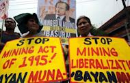Anti-mining protestors stage a rally near Malacanang Palace in Manila on Tuesday. President Benigno Aquino's newly-released order revamping the Philippine mining sector needs more work, his spokesman said Tuesday as activists assailed the new regulations