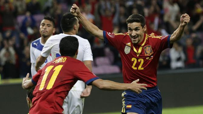 Spain's Jesus Navas, right, celebrates scoring his side's second goal with teammate Pedro Rodriguez, left, during a friendly soccer match between Spain and Chile at the Stade de Geneve stadium, in Geneva, Switzerland, Tuesday, Sept, 10, 2013