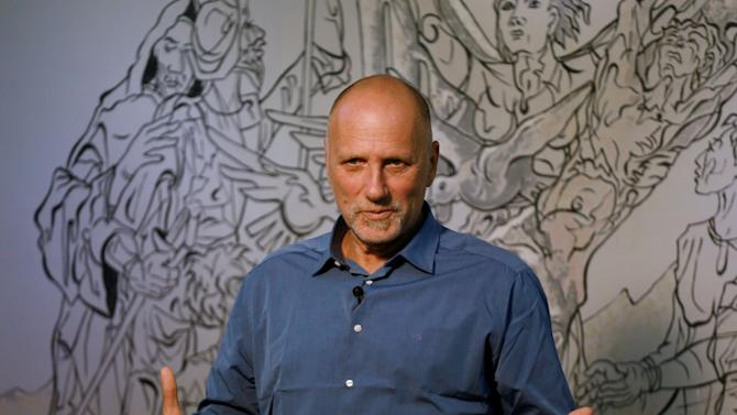 "Israeli adventurer Yossi Ghinsberg lost in the Bolivian jungle and author of a book title ""Jungle"", speaks during a conference in La Paz"