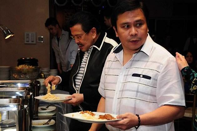 MANILA, Philippines - Former President Joseph Estrada and his son Senator Jinggoy Estrada, seen during the surprise birthday party prepared by Tirso Cruz's family, as he celebrates his 60th birthday held in EMAR Suites in Mandaluyong city, east of Manila on 01 April 2012. (George Calvelo/NPPA Images