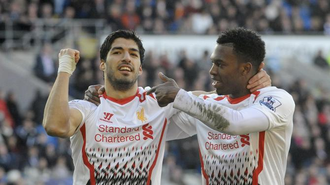 Liverpool's Daniel Sturridge celebrates scoring a goal with Luis Suarez (L) against Cardiff City during their English Premier League soccer match at Cardiff City Stadium in Cardiff,
