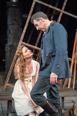 """This undated publicity image released by the Brooklyn Academy of Music shows Wrenn Schmidt, left, and John Turturro in a scene from Henrik Ibsen's """"The Master Builder,"""" currently performing at the BAM Harvey Theater in  New York. (AP Photo/Brooklyn Academy of Music, Stephanie Berger)"""