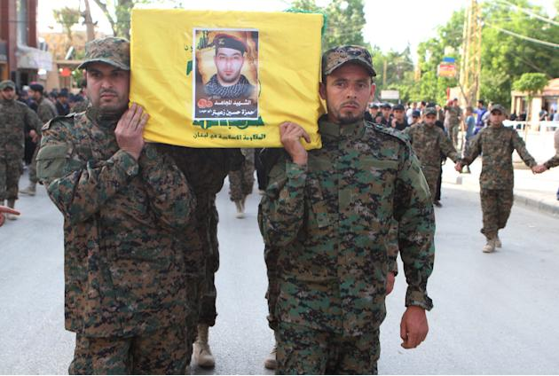 Lebanon's Hezbollah members carry the coffin of their fellow fighter Hamza Zaiter during his funeral in Baalbek, in the Bekaa valley