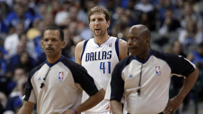 Dallas Mavericks' Dirk Nowitzki (41) argues a technical foul against him as referees Eric Lewis, left, and Derek Richardson walk away during the second half of an NBA basketball game against the Portland Trail Blazers, Saturday, Jan. 18, 2014, in Dallas. The Trail Blazers won 127-111