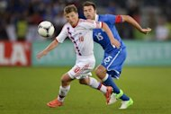 Russia's forward Andrey Arshavin (L) fights for the ball with Italy's defender Andrea Barzagli during their friendly football match in Zurich. Russia won 3-0
