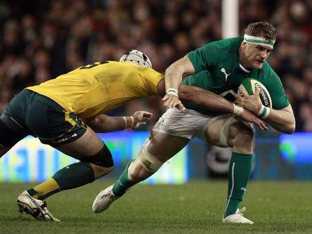 Ireland's Heaslip is challenged by Australia's Mowen during their International rugby union match in Dublin