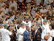 NBA Finals MVP LeBron James of the Miami Heat holds the championship trophy after defeating the Oklahoma City Thunder in Game Five of the NBA Finals, on June 21, at the American Airlines Arena in Miami, Florida. The Heat won 121-106 to capture the best-of-seven championship series four games to one