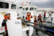 Members of South Korean Coast Guard participate in a drill at port Pohang, in 2006. A Chinese fisherman died Tuesday after being hit by a rubber bullet during a raid by South Korean coast guard commandos on illegal fishing in the Yellow Sea, officials said